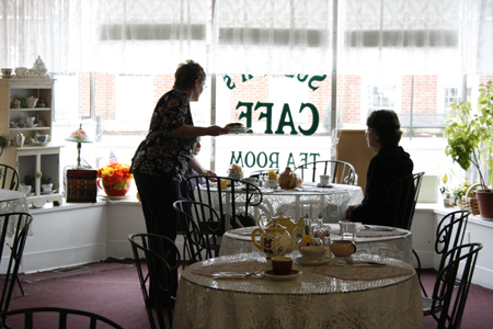 A pair of women are served during the lunch hours in front of the large windows looking out at the downtown district of Ravenna, OH.